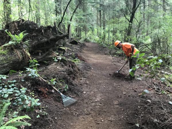 Price Sculpture Forest north loop trail building contractor performing hand work finishing