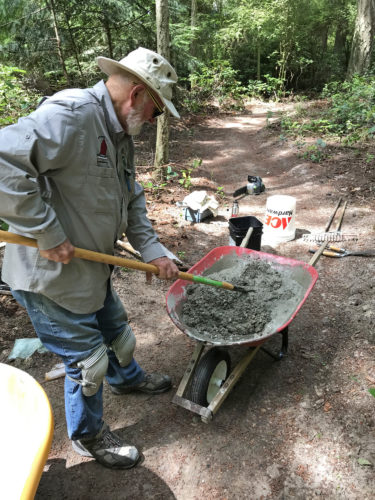 Ken Price mixing concrete for sculpture plinths at Price Sculpture Forest