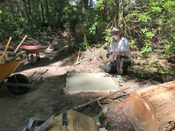 Scott Price working on first concrete sculpture plinth at Price Sculpture Forest