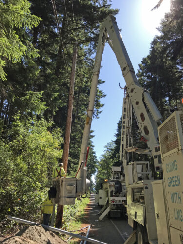 Puget Sound Energy PSE boom lift installing electricity at Price Sculpture Forest