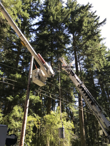 Puget Sound Energy PSE installing transformer on pole at Price Sculpture Forest