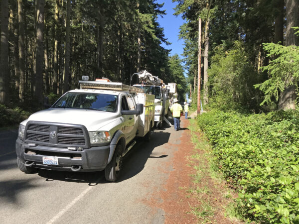 Puget Sound Energy PSE team and trucks connecting electricity at Price Sculpture Forest