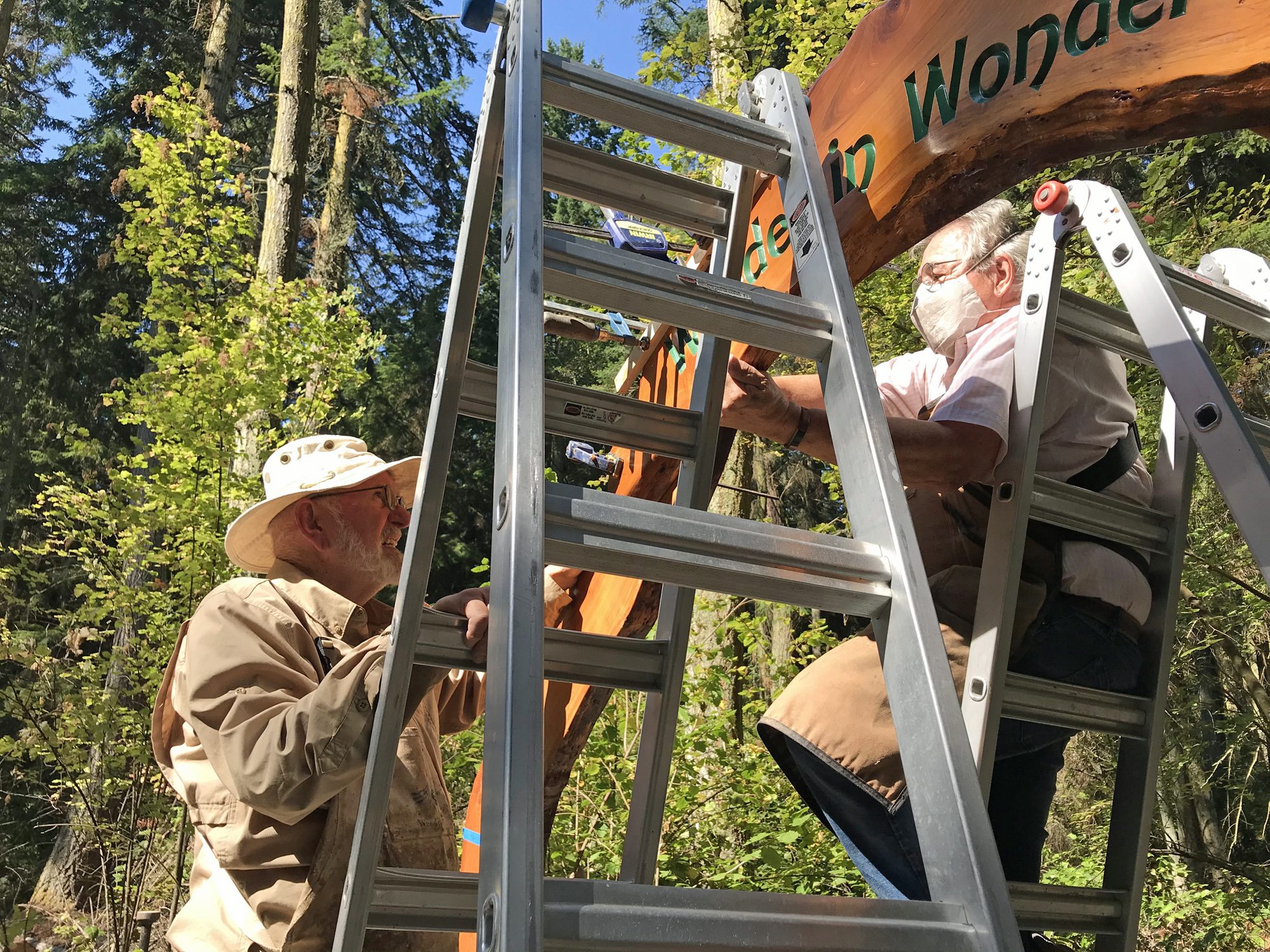 Ken Price and Michael Hauser assembling Wonder In Wonder arch at Price Sculpture Forest Coupeville Whidbey Island sculpture park