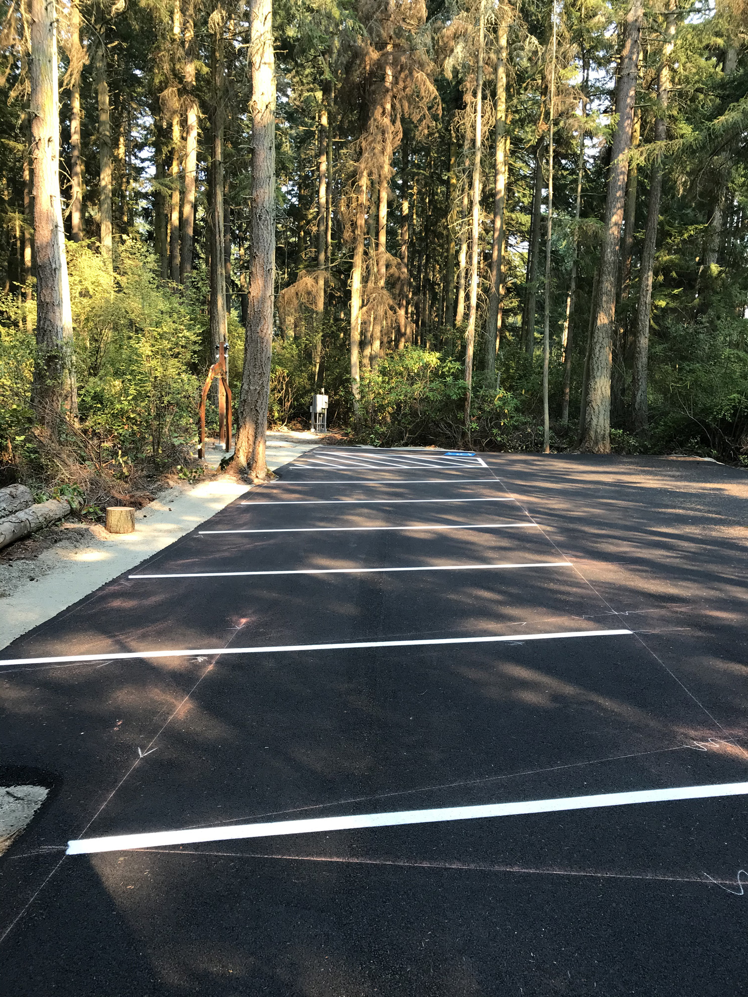 Parking lot striping at Price Sculpture Forest sculpture park in Coupeville on Whidbey Island