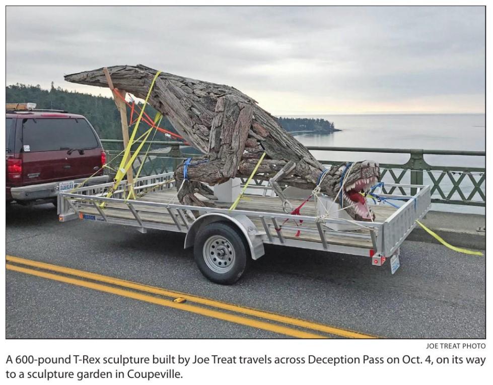 Skagit Valley Herald photo of Joe Treat T Rex sculpture crossing Deception Pass Bridge to Price Sculpture Forest - closeup