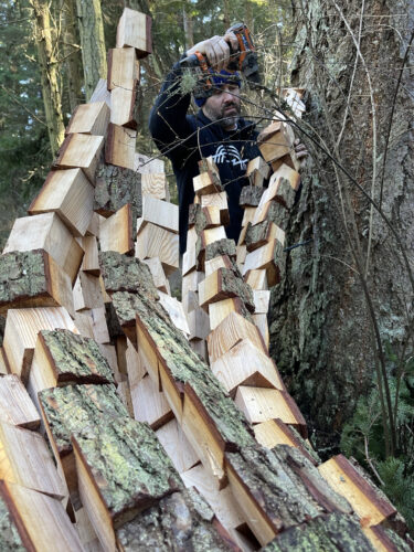 Artist Anthony Heinz May adding wood blocks at Price Sculpture Forest in Coupeville Whidbey Island
