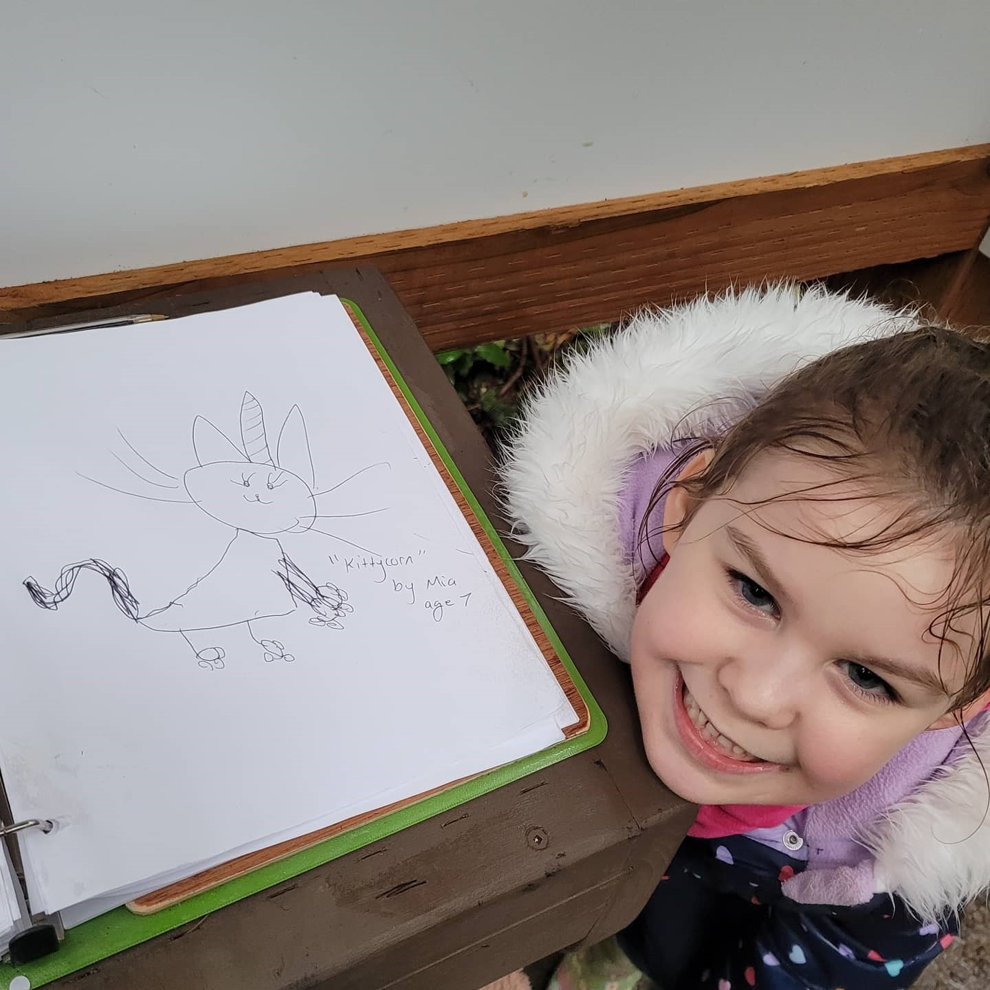 Daughter Mia age 7 draws in Participation Book at Price Sculpture Forest - by Jessica Kanehen of Stanwood WA