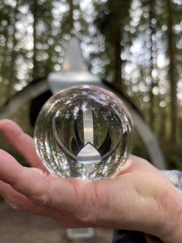 Larry Symons of Bellingham photo of Gary Gunderson Pentillium through glass ball at Price Sculpture Forest