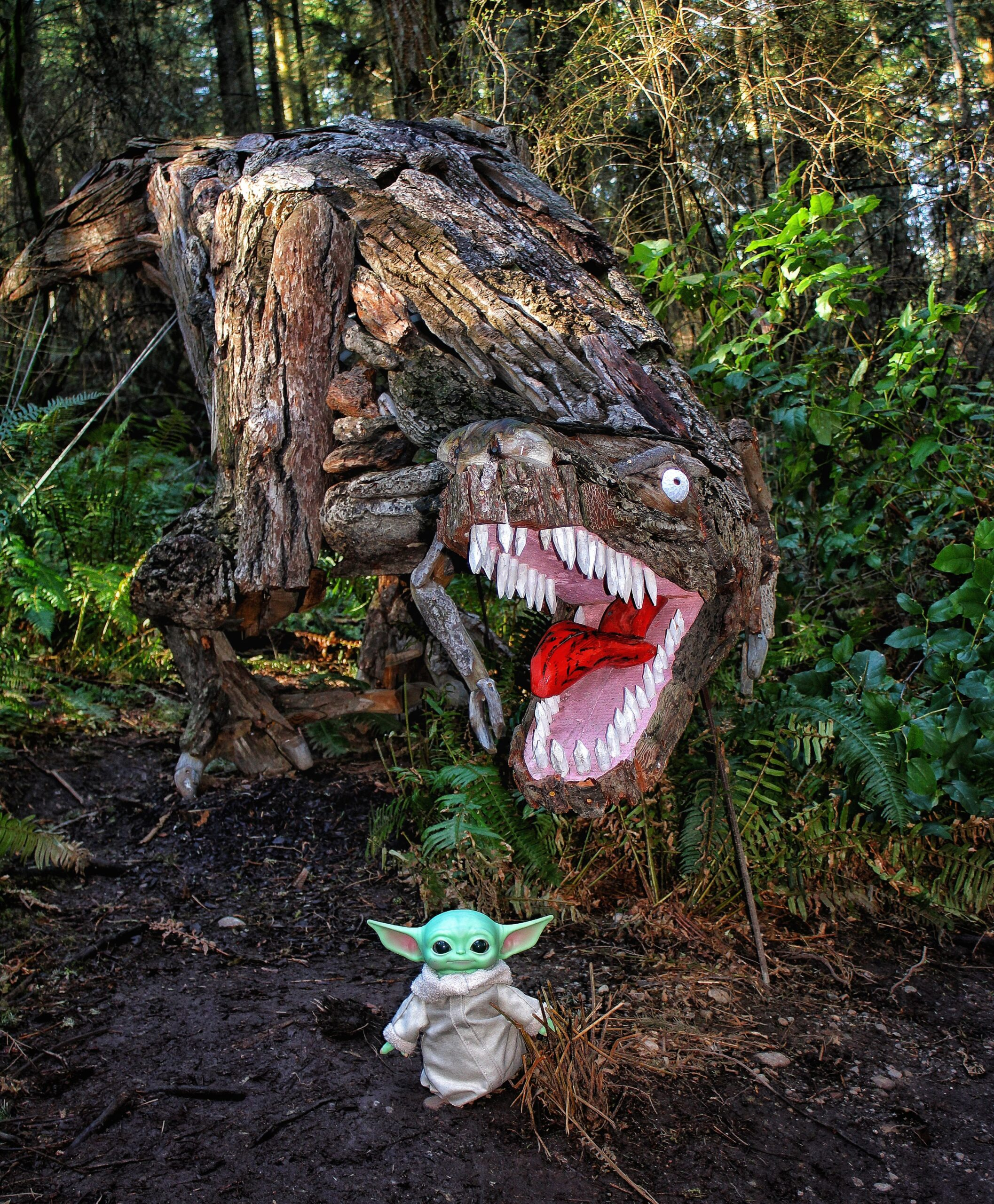 Joe Treat Tyrannosaurus Rex with Baby Yoda Grogu at Price Sculpture Forest - photo by Calex Haney from Oak Harbor WA Instagram concordiaphotos