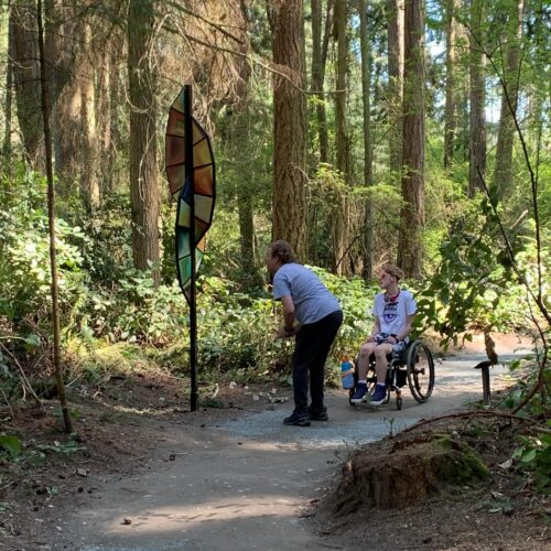 Shane and Xander observing Kirk Seese The Feather at Price Sculpture Forest photo by Martin Pearce of Bellevue WA