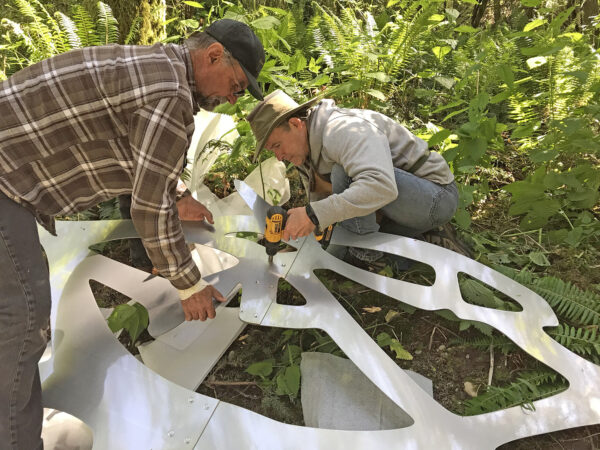 Bob Davenport and Scott Price with Ken Price assembling Flying Fish by Daniella Rubinovitz at Price Sculpture Forest