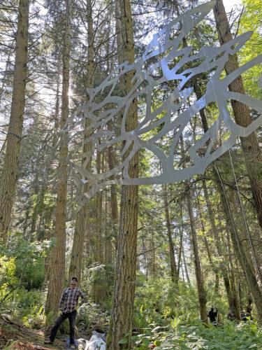 Bob Davenport under Daniella Rubinovitz Flying Fish at Price Sculpture Forest
