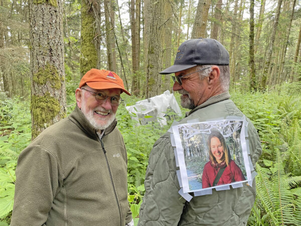 Ken Price and Bob Davenport with photo of Daniella Rubinovitz at installation site of Flying Fish at Price Sculpture Forest
