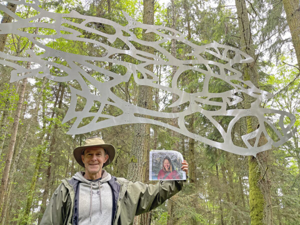 Scott Price with honorary onsite photo of Daniella Rubinovitz by her Flying Fish at Price Sculpture Forest