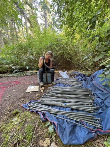 Jenni Ward working on initial construction of Lichen Series Spore Patterns at Price Sculpture Forest park